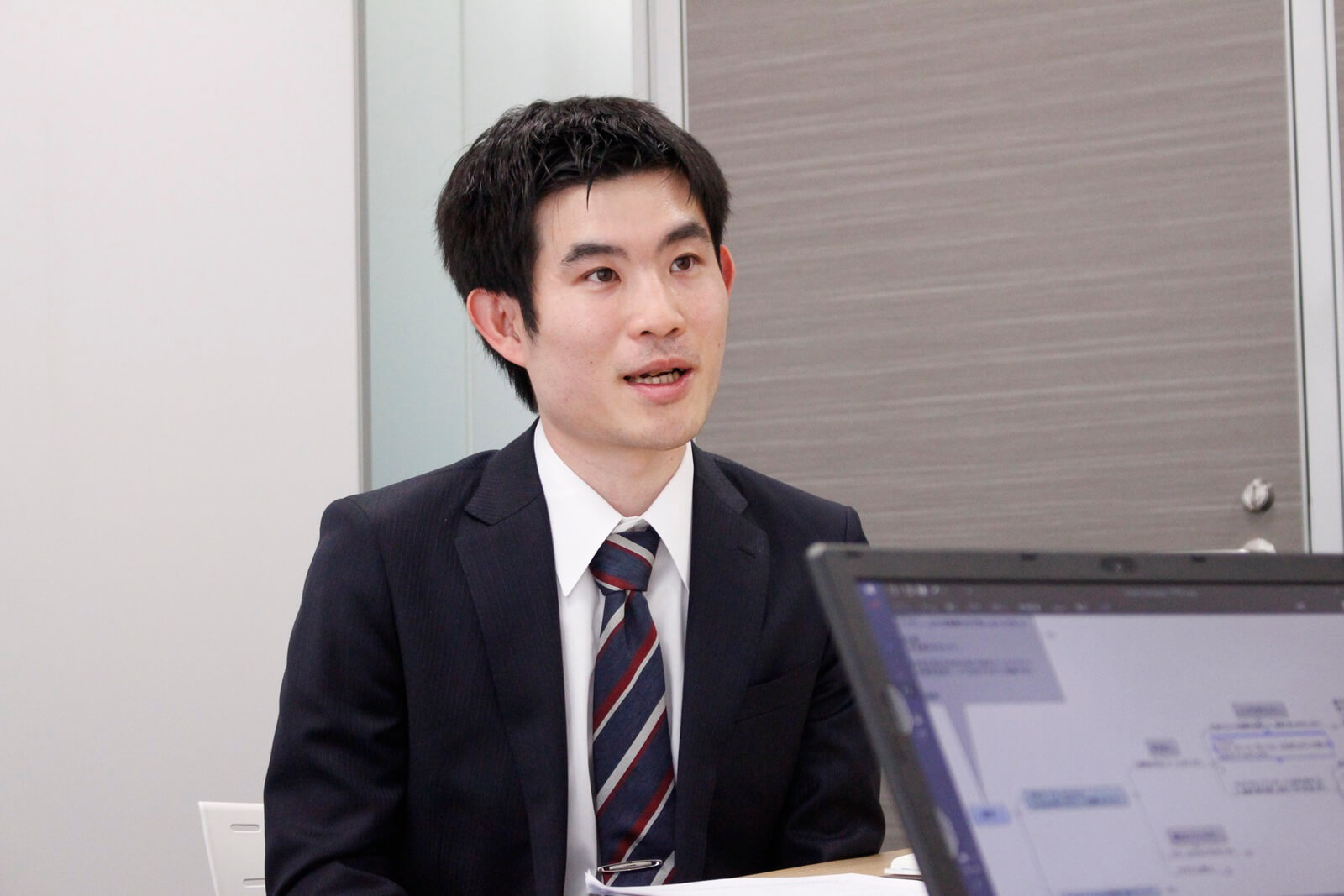 MoneyT Globalについてインタビューを受ける北田氏